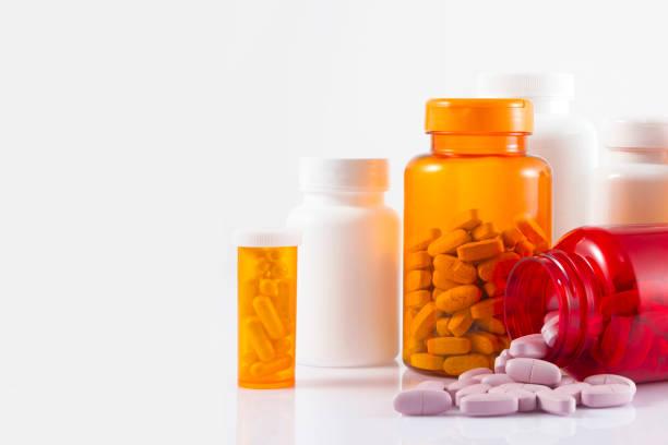 Pill Bottles on White Background stock photo