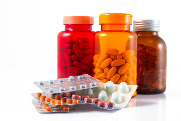 Pill Bottles Close-up shot of colorful pill bottles pill container stock pictures, royalty-free photos & images