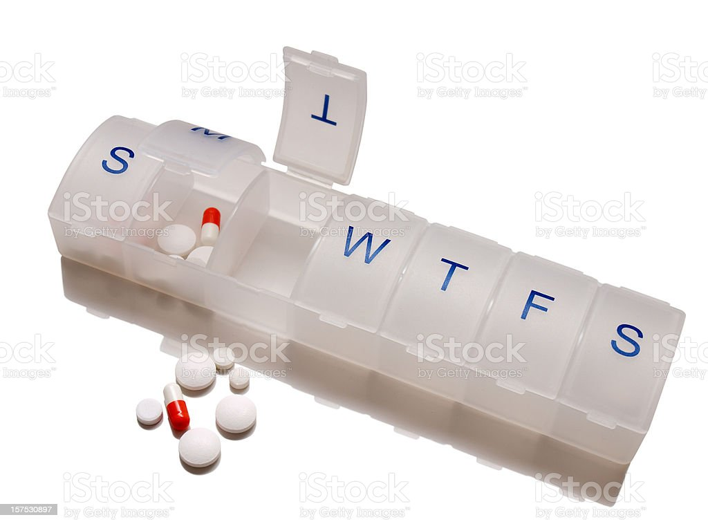 Pill box with tablets and capsules stock photo