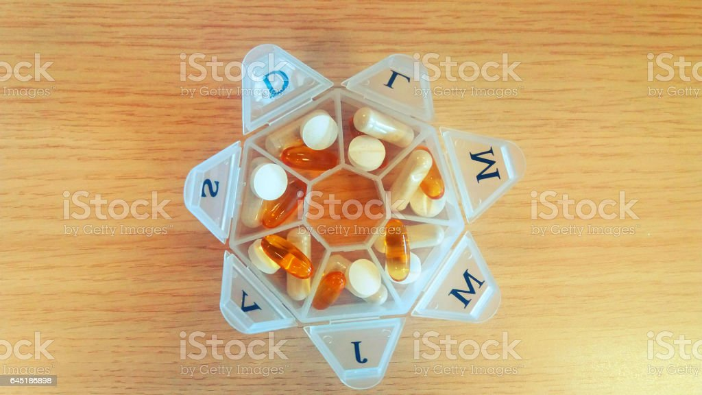 Pill container with vitamins stock photo