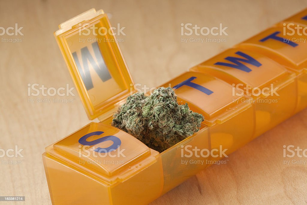 pill dispenser with Marijuana royalty-free stock photo