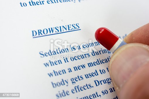 Pill held above an adverse medicinal side effects- drowsiness