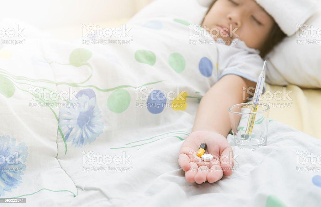 pill in little girl hand stock photo