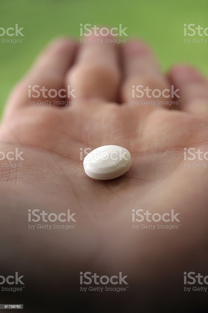 Pill on your hand royalty-free stock photo