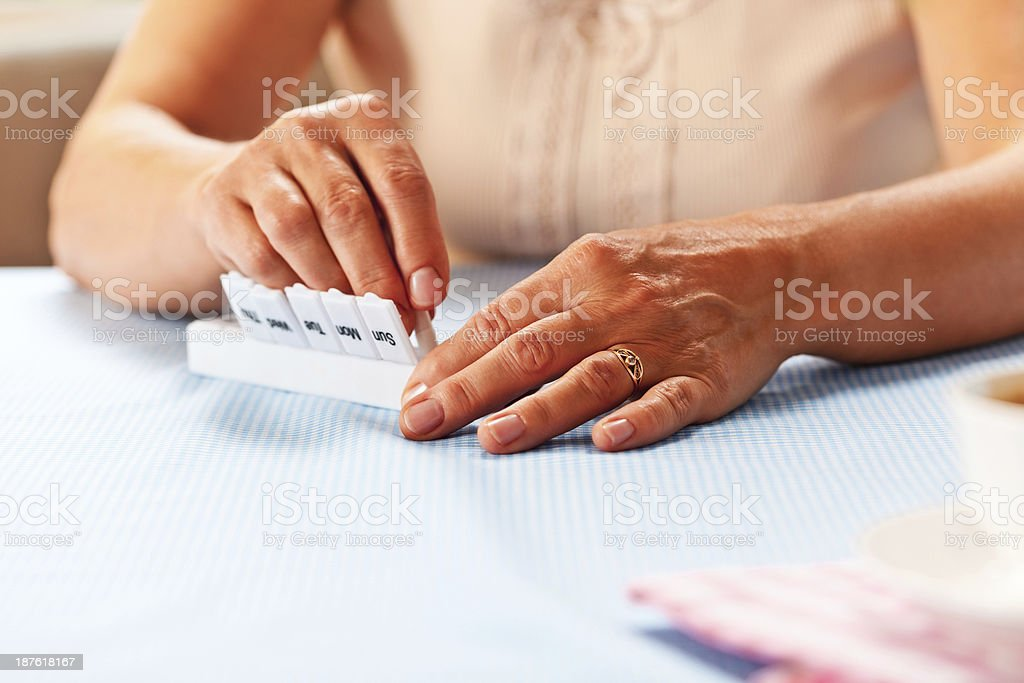 Pill organizer stock photo