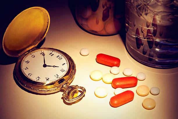 pill time - sleeping pill stock photos and pictures