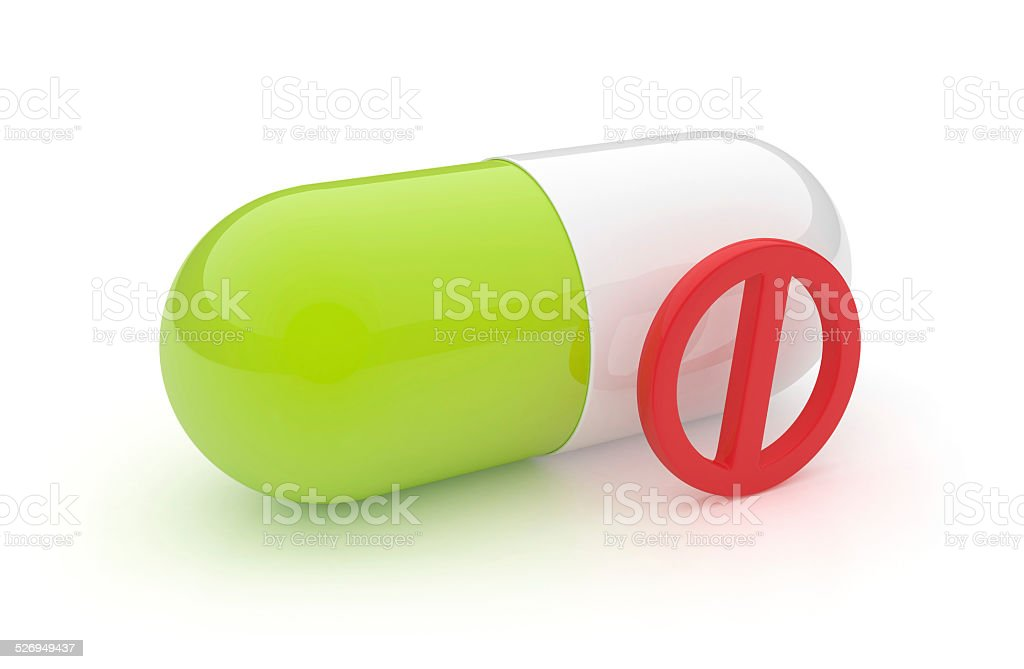 3D pill with forbidden symbol stock photo