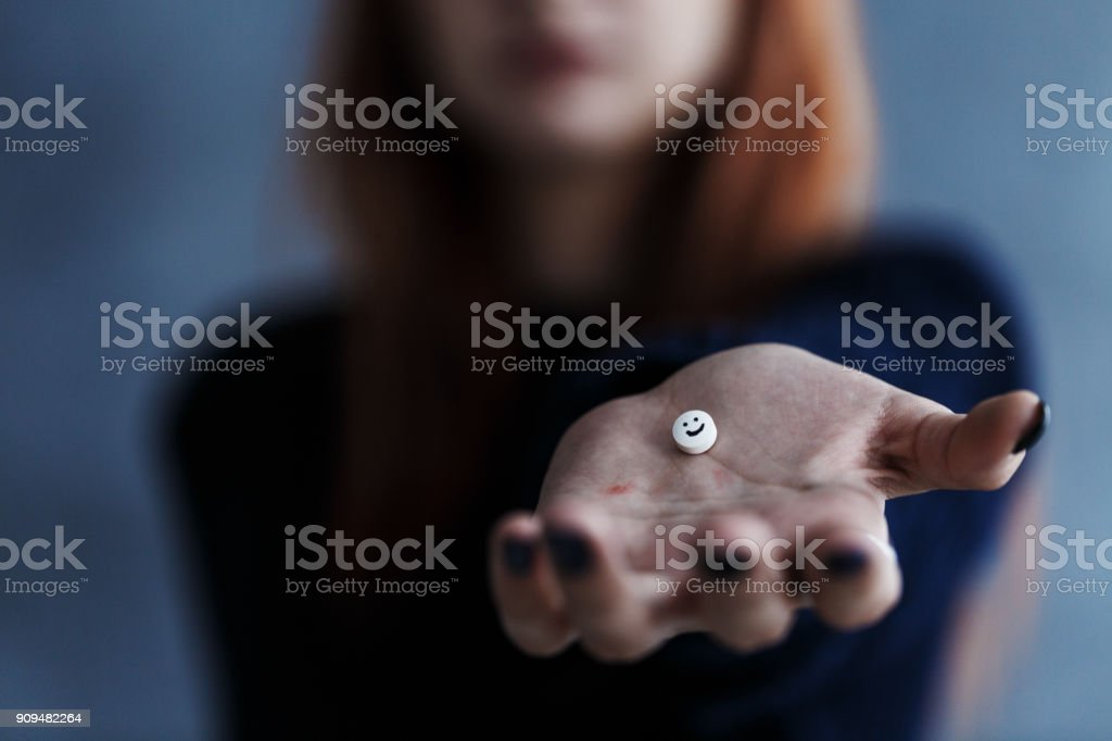 Pill with smiley face stock photo