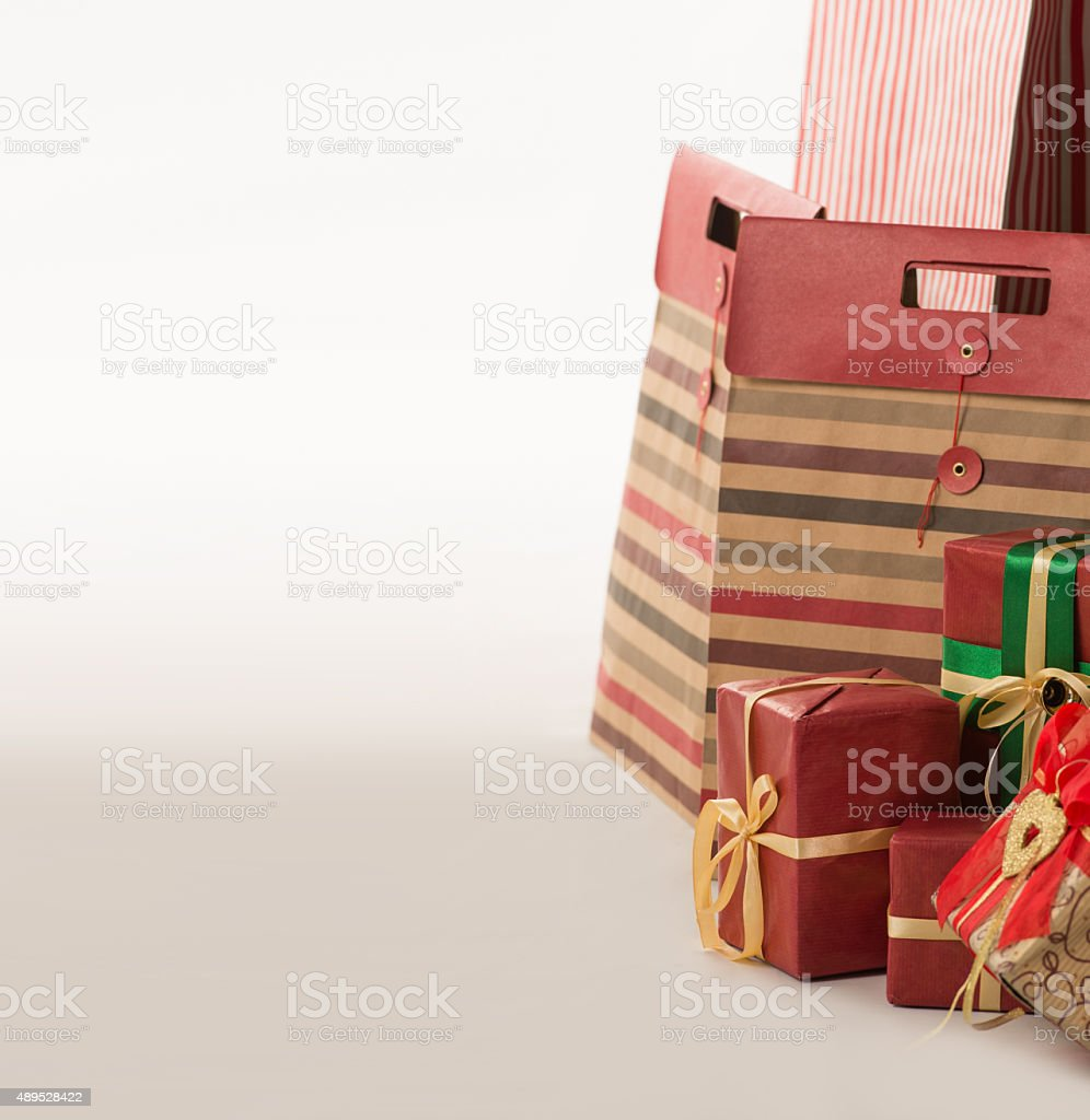Pillar of boxes with presents wrapped in red paper stock photo