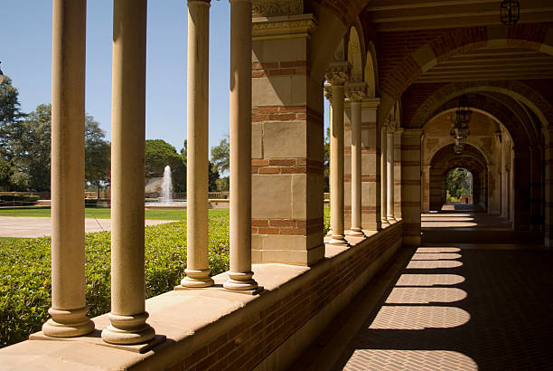 Pillared external corridor of a classically styled building Columns of a building at a university. ucla stock pictures, royalty-free photos & images