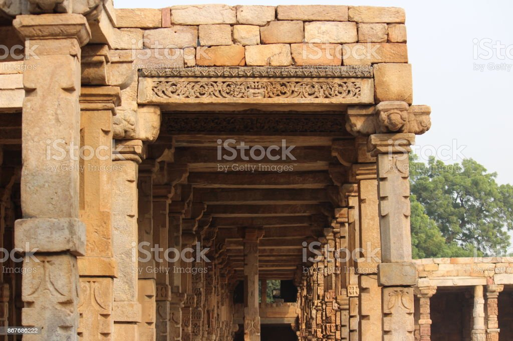 Pillars at Qutab Minar complex stock photo