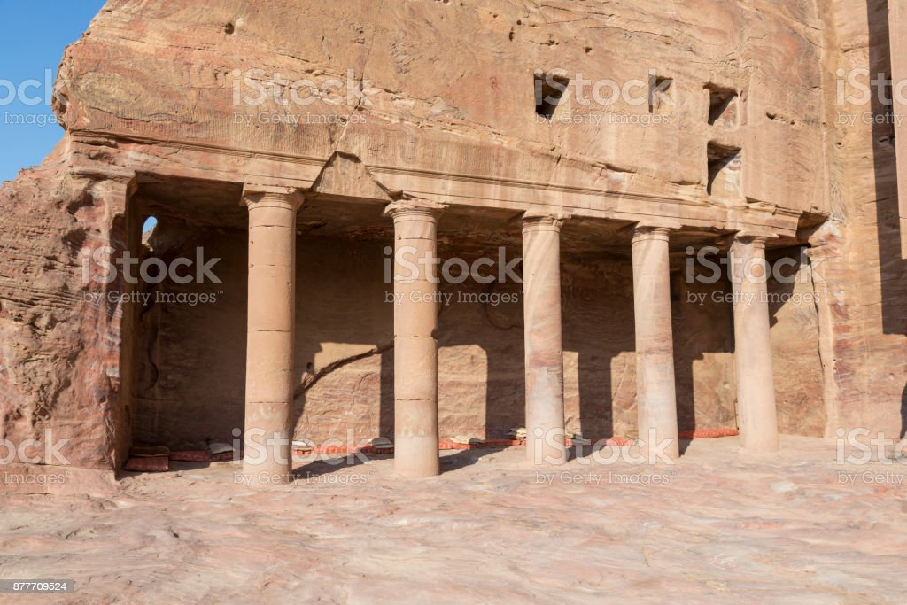 Pillars inside the Royal Tombs in the ancient city of Petra, Jordan stock photo