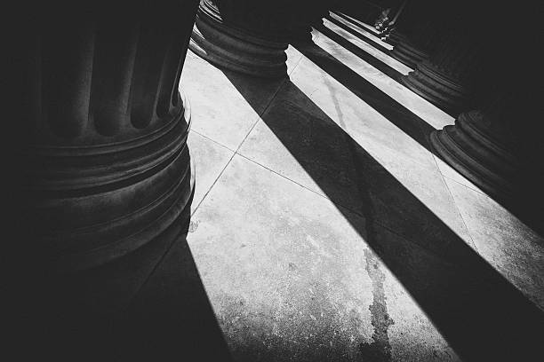 Pillars of light Streams of light and shadows from pillars. architectural column stock pictures, royalty-free photos & images