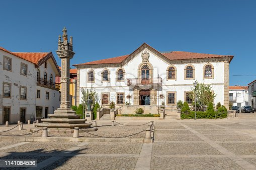 View of the sixteenth century gothic manueline style granite pillory and the city hall building of Vila Nova de Foz Coa, Portugal