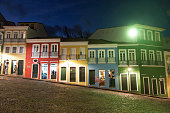 Salvador, Bahia, Brazil - October 3, 2012: In the late afternoon, few people inside a snackshop, ice cream and souvenir shops in a very inclined street of Pelourinho district.