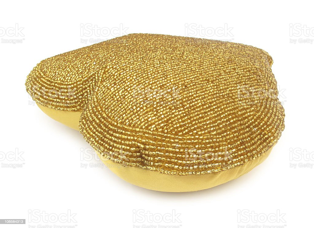 Pillow golden heart shaped home decoration royalty-free stock photo
