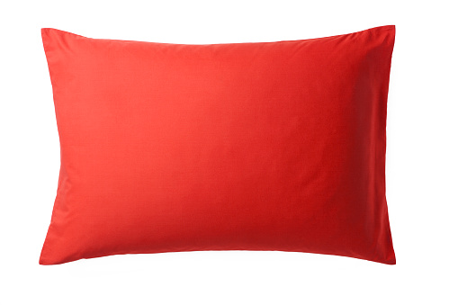 Red Pillow isolated on White Background. Top View of a Soft Colorful Pillow with Copy Space for Tex or Image