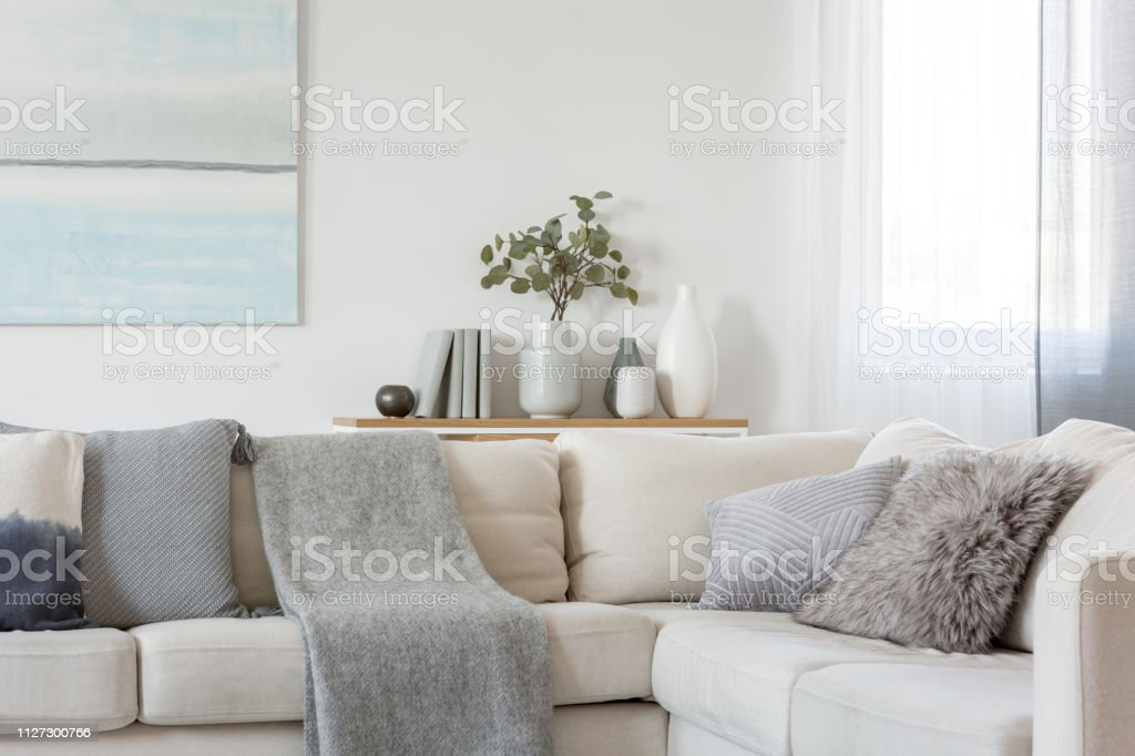 Pillows And Blanket On Comfortable Beige Corner Sofa In ...