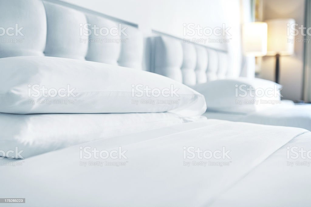 pillows arranged on bed royalty-free stock photo