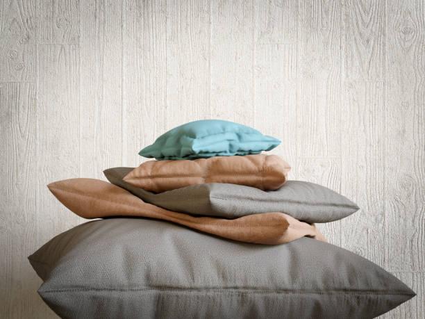 pillows collection as mountain peak relax and comfort concept composition photo - pyramide sammlung stock-fotos und bilder