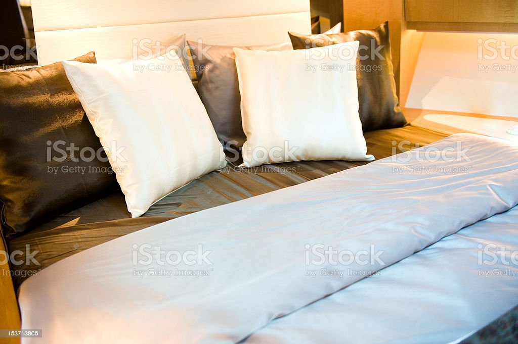 pillows in bed royalty-free stock photo