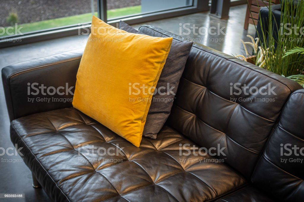 Commercial Office Paint Color Ideas, Pillows On Black Leather Couch Interior Design Sample Stock Photo Download Image Now Istock