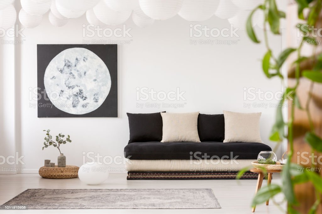 Stupendous Pillows On Black Sofa In White Living Room Interior With Machost Co Dining Chair Design Ideas Machostcouk