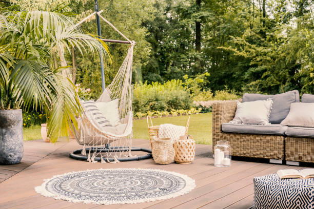 pillows on hammock on terrace with round rug and rattan sofa in the garden. real photo - amaca foto e immagini stock