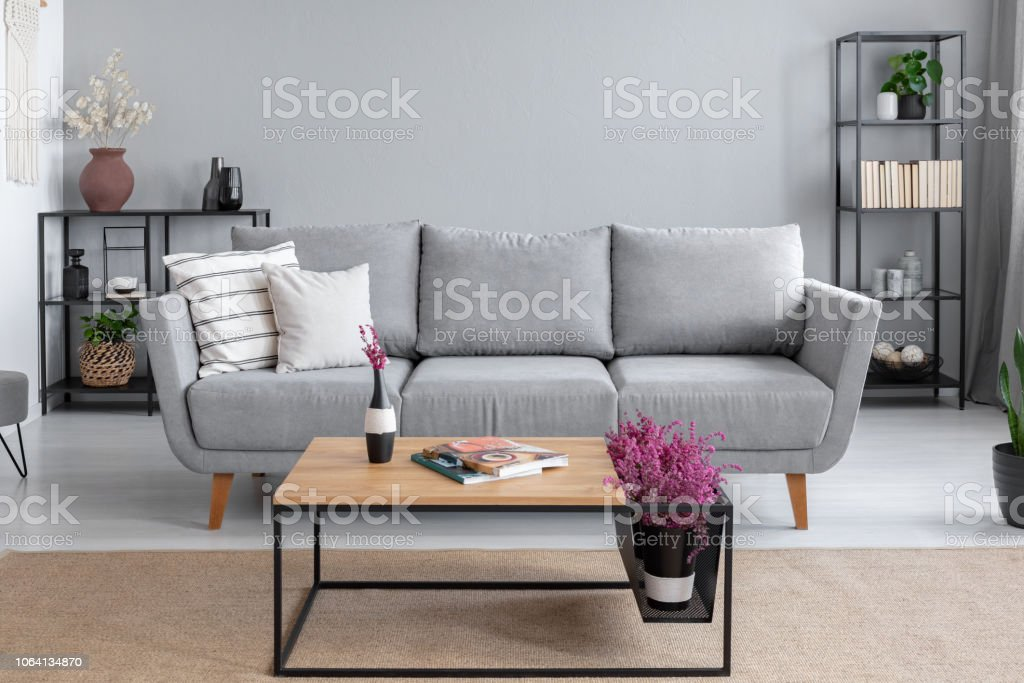 Pillows On The Comfortable Grey Couch In Stylish Living Room