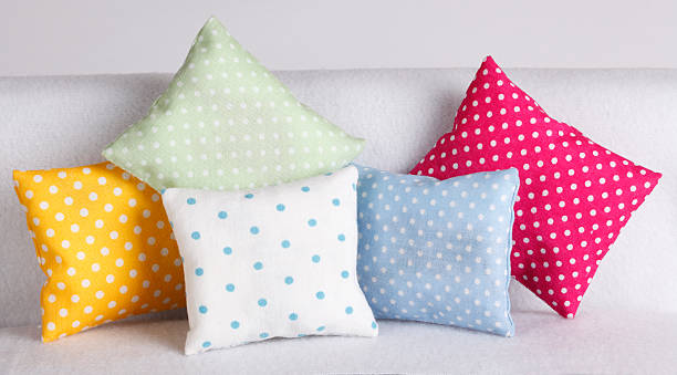Pillows Colorful pillows with polka dots cushion stock pictures, royalty-free photos & images