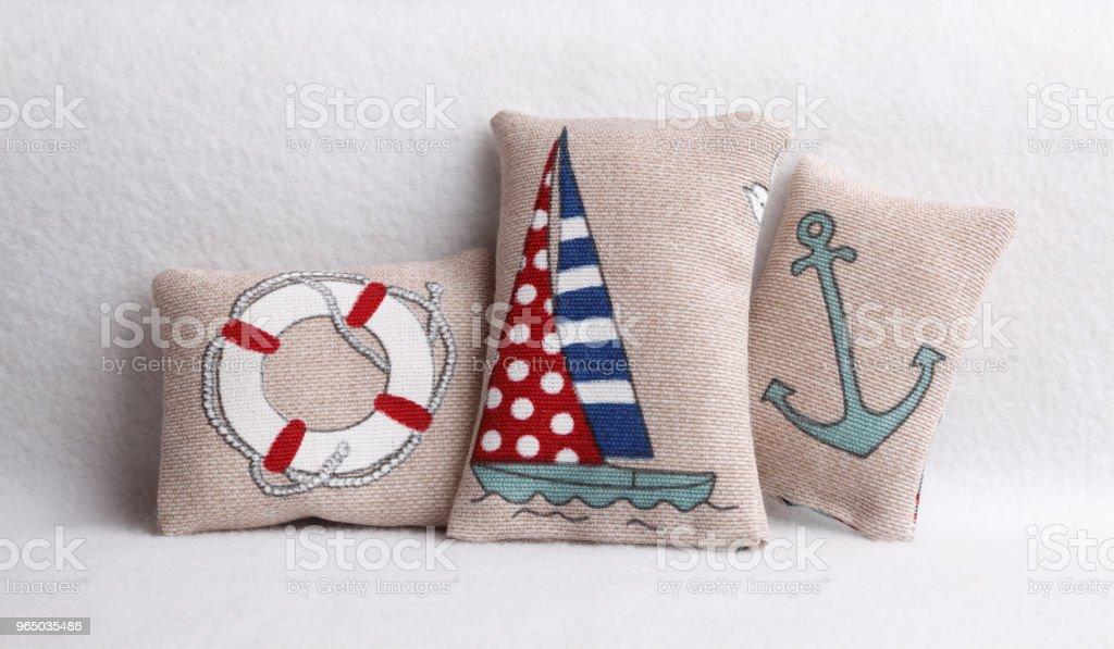 Pillows with sea symbols zbiór zdjęć royalty-free