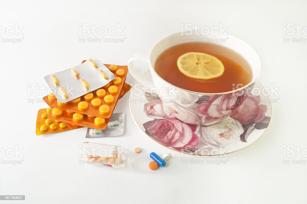 Pills and a cup of lemon tea royalty-free stock photo