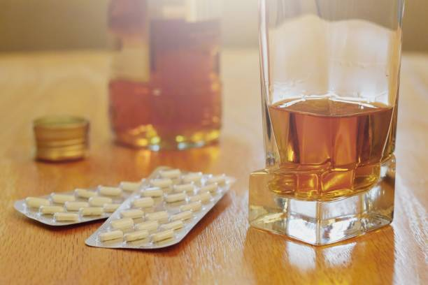 Pills and alcohol on the table, dependency concept Dependency concept recreational drug stock pictures, royalty-free photos & images