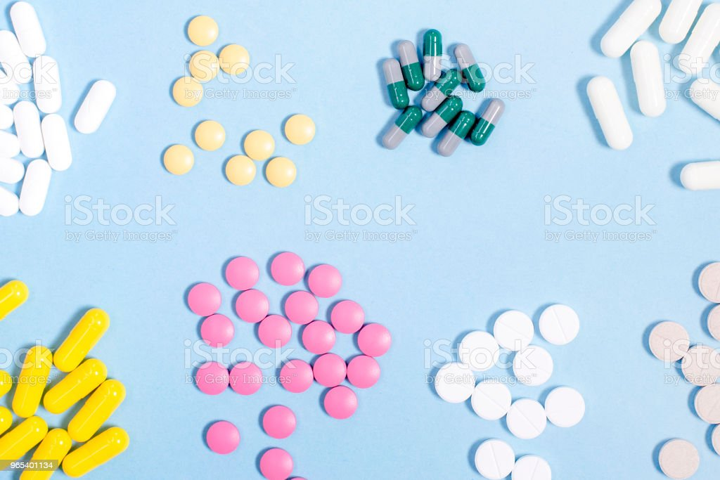Pills  and capsules on blue zbiór zdjęć royalty-free