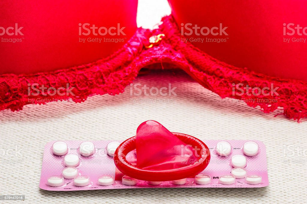 Pills and condom with red bra – Foto