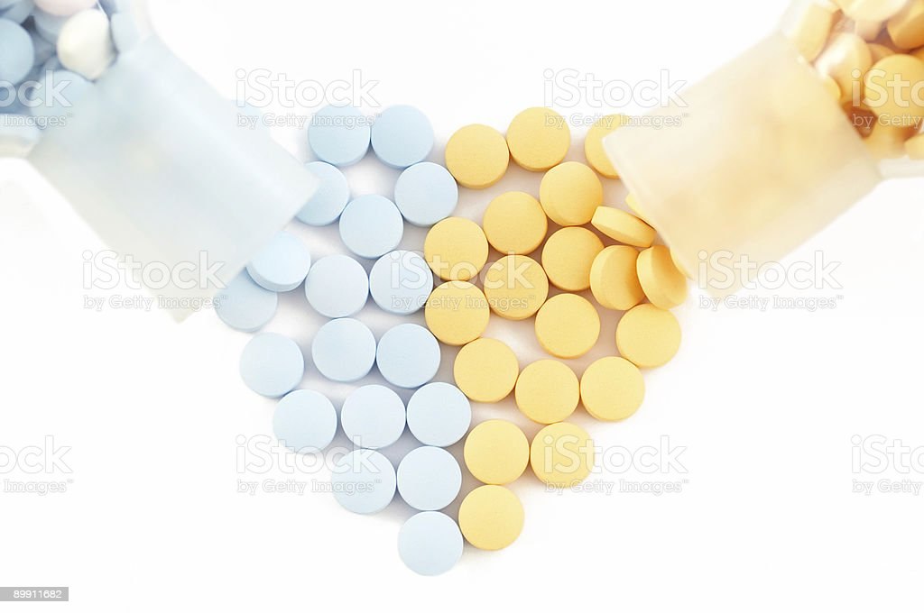 pills and drugs forming heart on white royalty-free stock photo