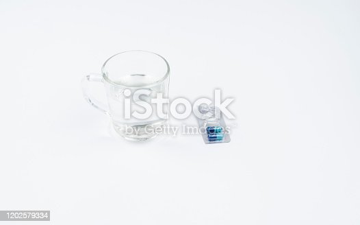 Pills and glass of water isolated