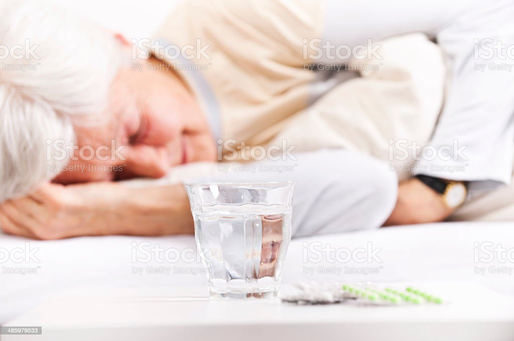 Pills and glass of water royalty-free stock photo