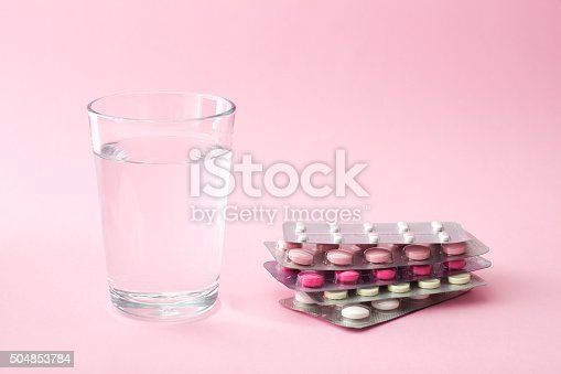 istock Pills and glass of water 504853784