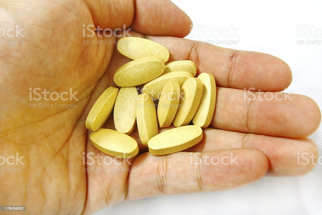 pills and hand royalty-free stock photo