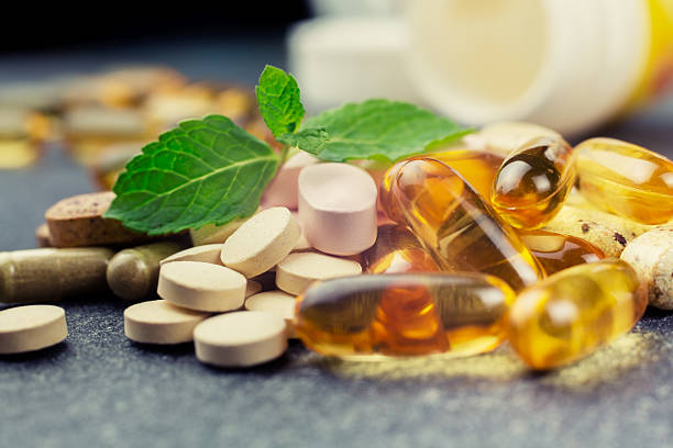 pills and multivitamins - vitamin stock pictures, royalty-free photos & images