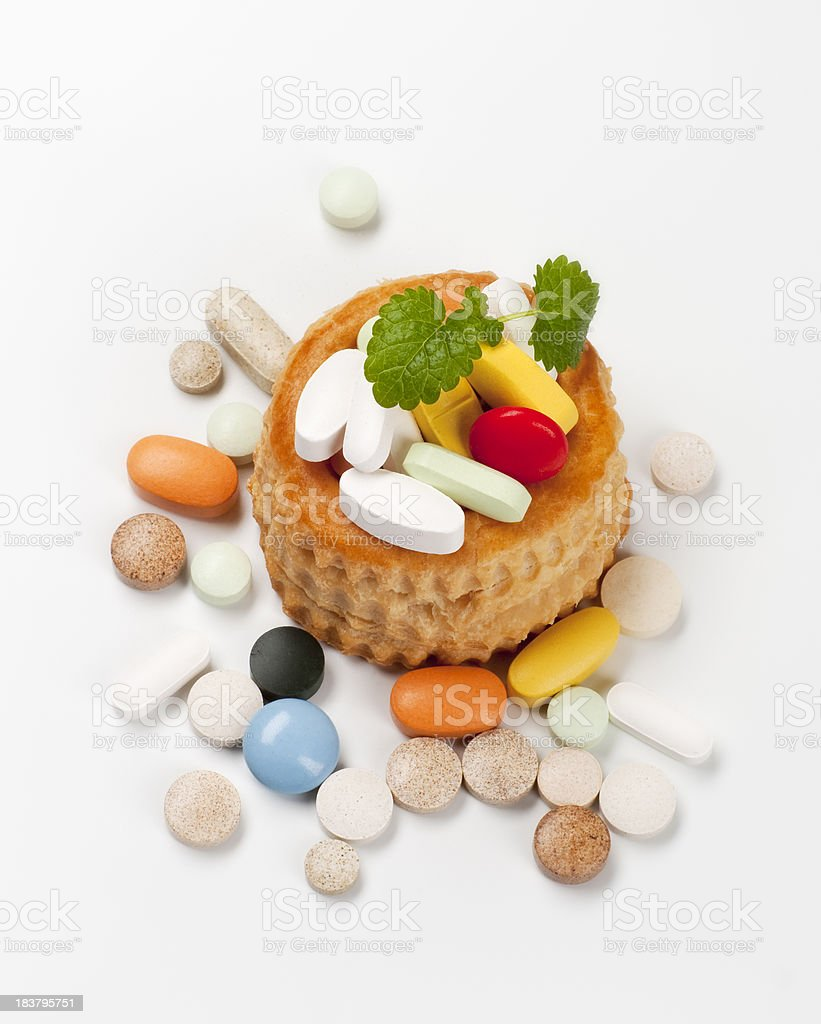 Pills and pastry royalty-free stock photo