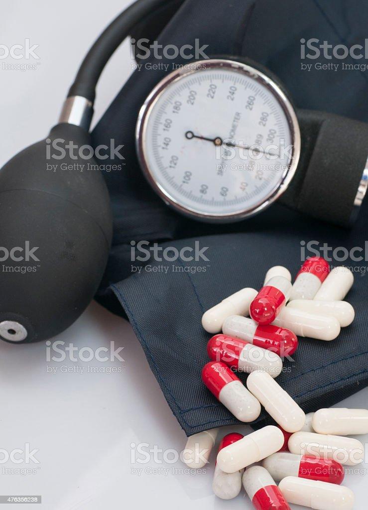 Pills and sphygmomanometers. stock photo