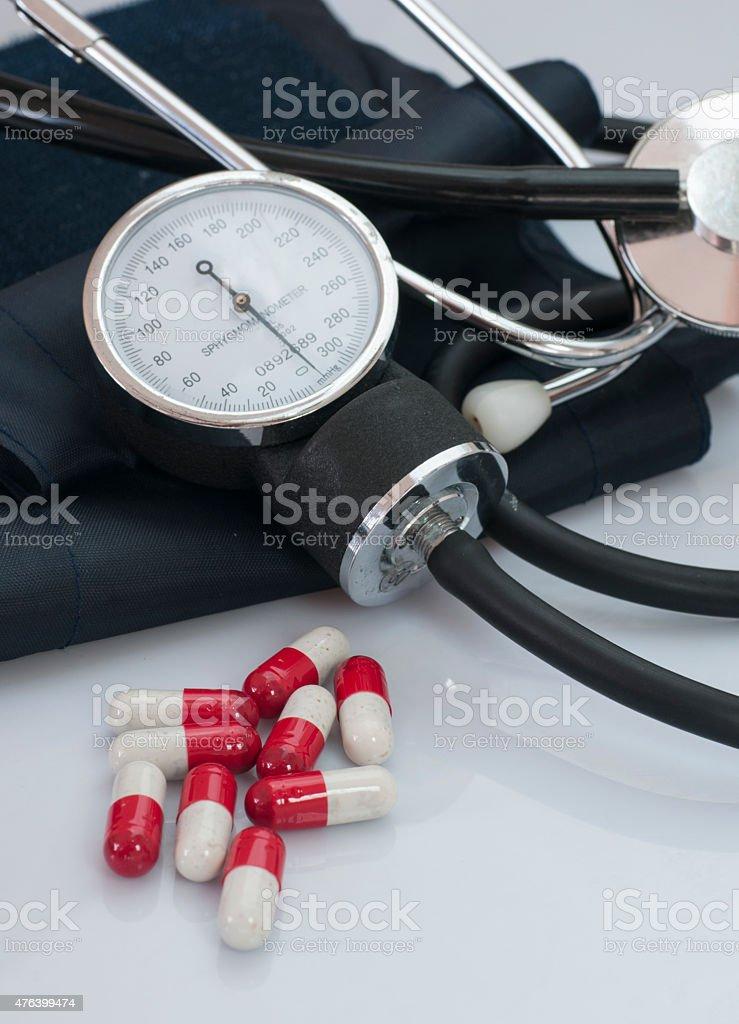 Pills and sphygmomanometers stock photo