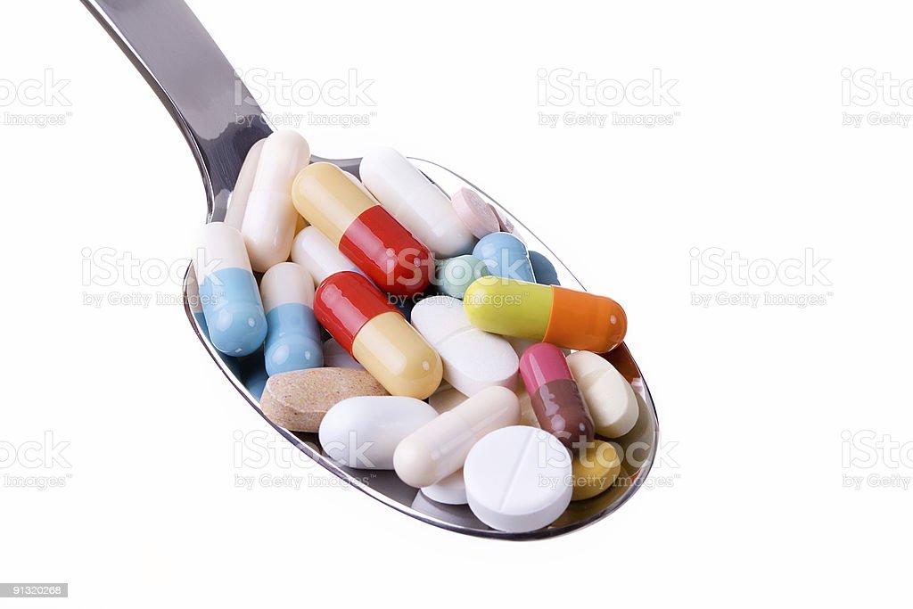 Pílulas e Colher - fotografia de stock