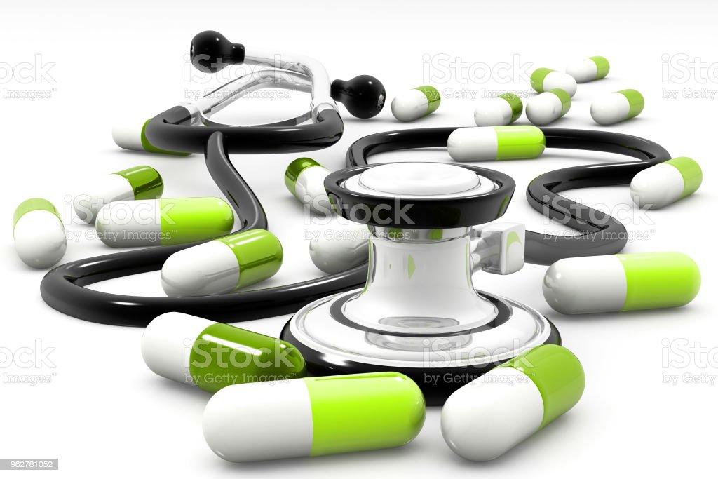 Pílulas e Estetoscópio - Foto de stock de Alívio royalty-free