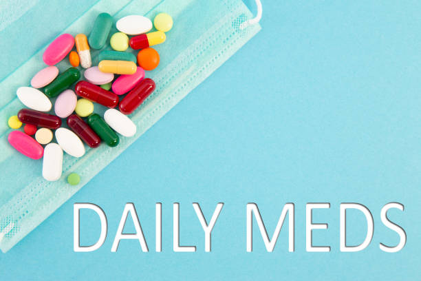 pills and surgical mask with daily meds text - prescription meds stock pictures, royalty-free photos & images