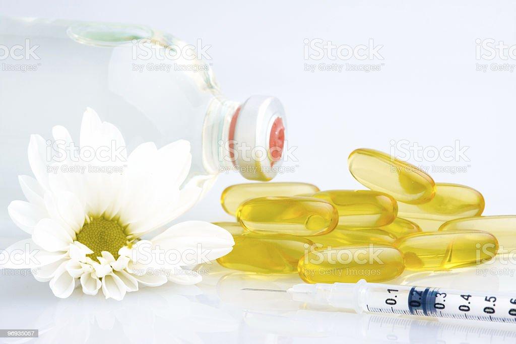 Pills and syringe royalty-free stock photo