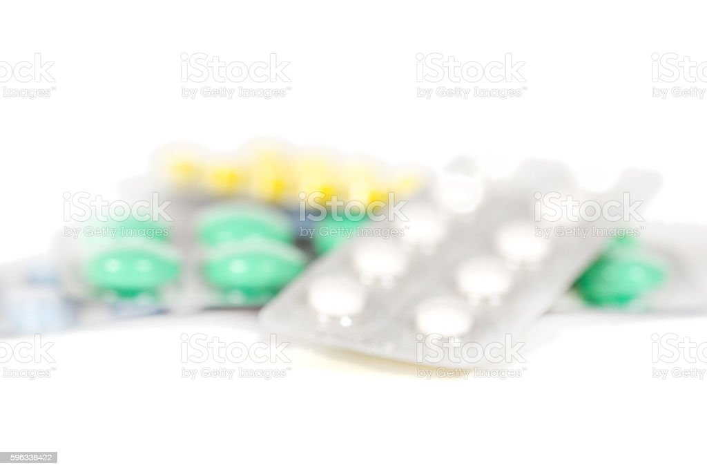 pills and tablets in blister blurred Lizenzfreies stock-foto