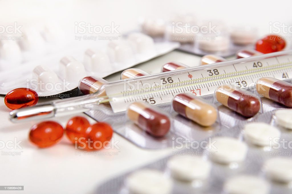 pills and thermometer stock photo